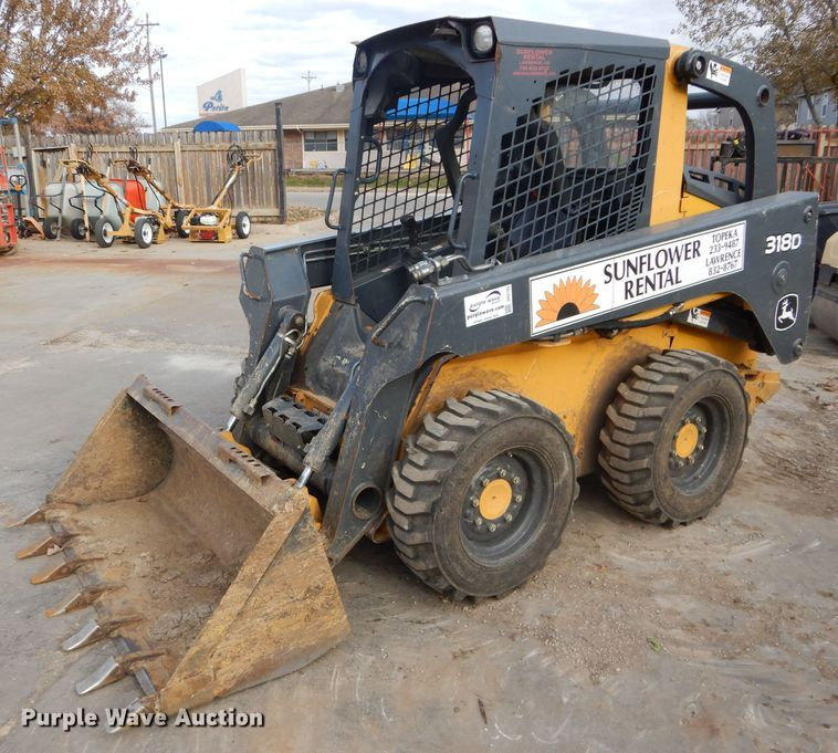 John Deere 318D Skid Steer for sale or rent sunflower equipment rental topeka lawrence kansas blue springs missouri