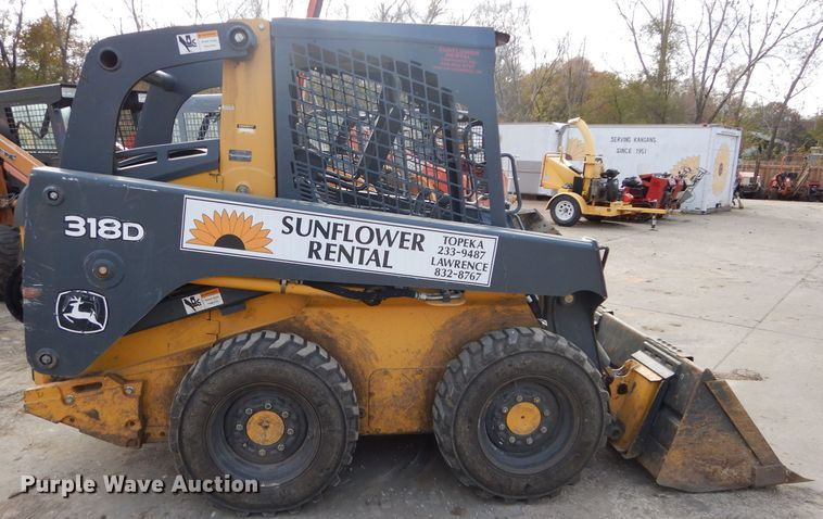 John Deere 318D Skid Steer for sale or rent sunflower equipment rentals topeka lawrence kansas blue springs missouri
